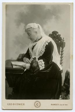 Mrs Eleanor Paton seated at a desk