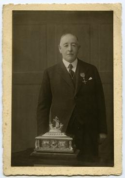 Alexander Robertson, retiring Town Clerk, wearing his OBE…