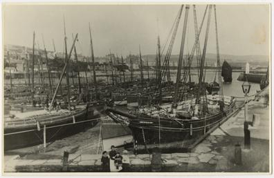 Port St Mary inner harbour, with a schooner,…