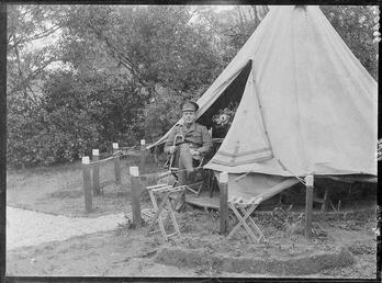 Lieutenant Charles Campbell in front of an Internment…