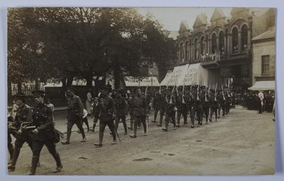 First World War soldiers marching through Ramsey, Parliament…